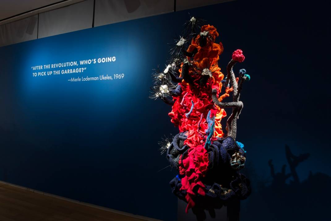 Reef sculture with wall text inside gallery
