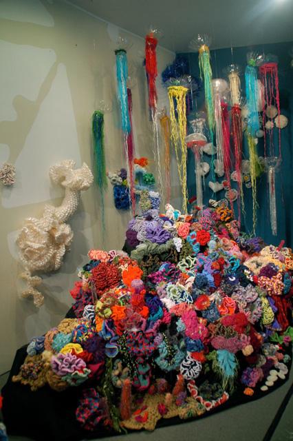 Detail of crochet coral reef sculptures in window vitrine.