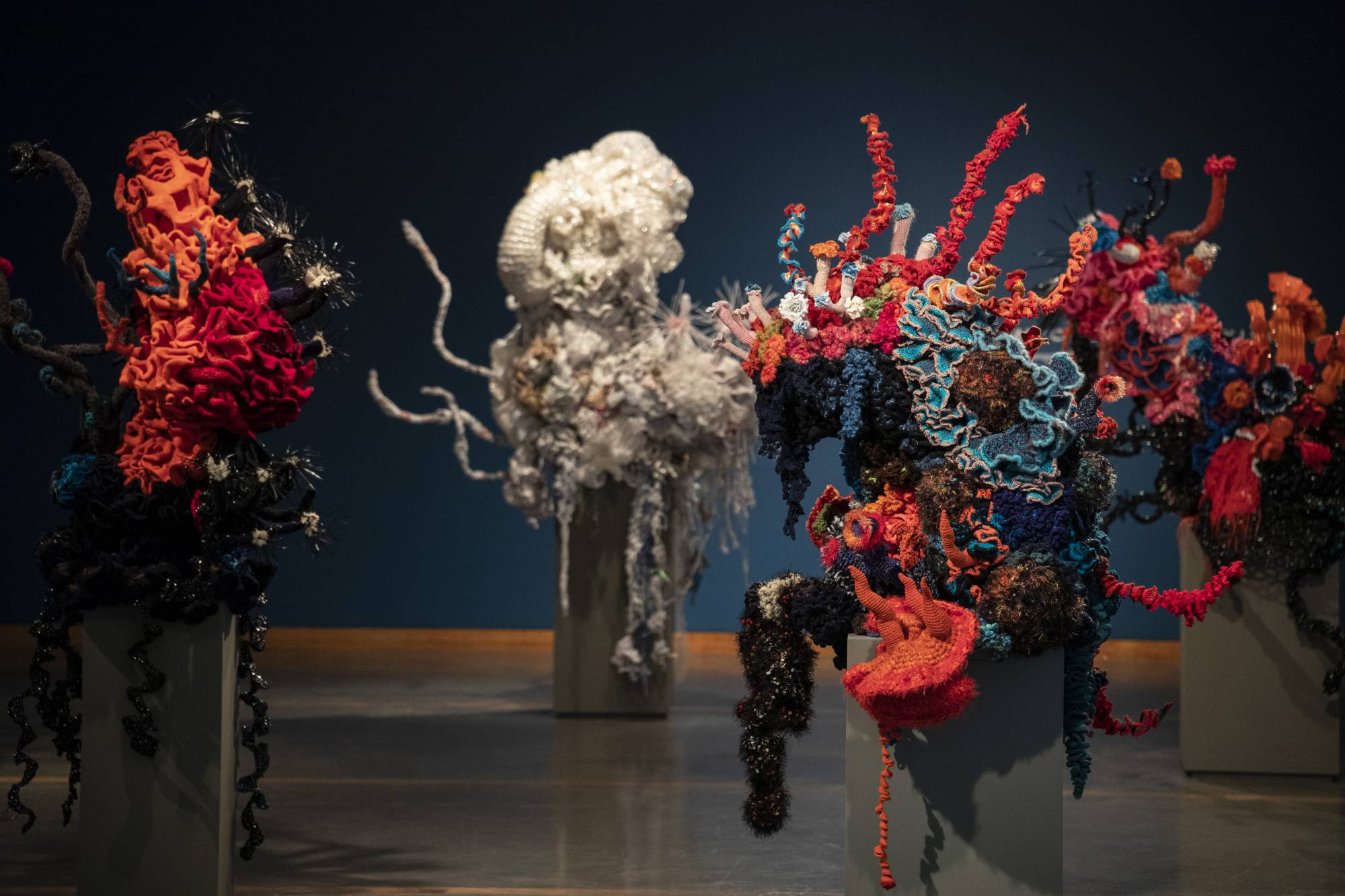 Giant co=richet sculptures made of yarn and plastic bags.