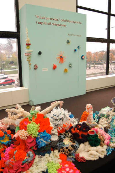 Installation view of crochet coral sculptures in gallery.
