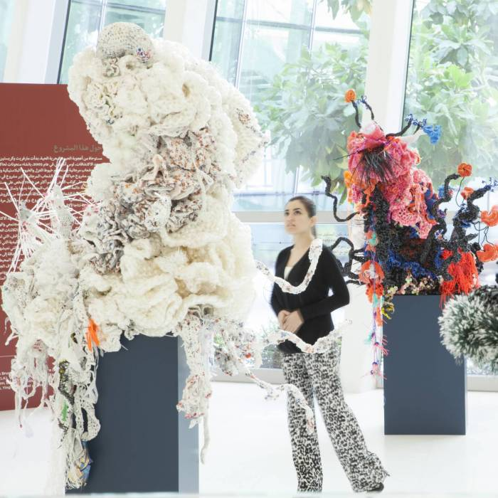large coral sculptures with person walking among them