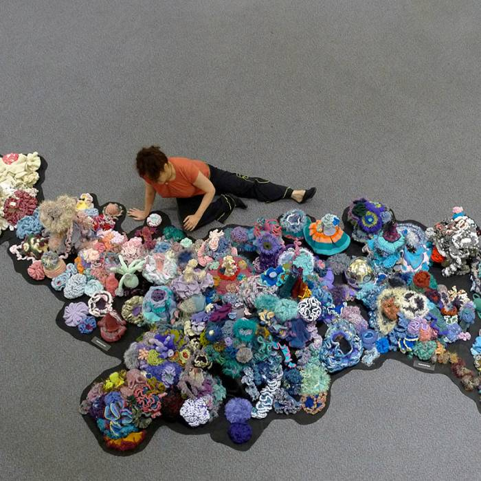 Person among reef sculpture in overhead shot