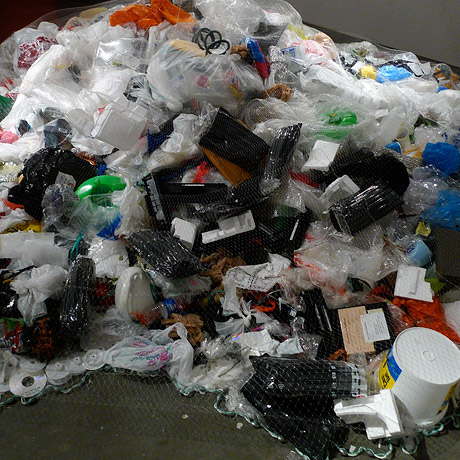 Detail of pile of plastic trash on the gallery floor.
