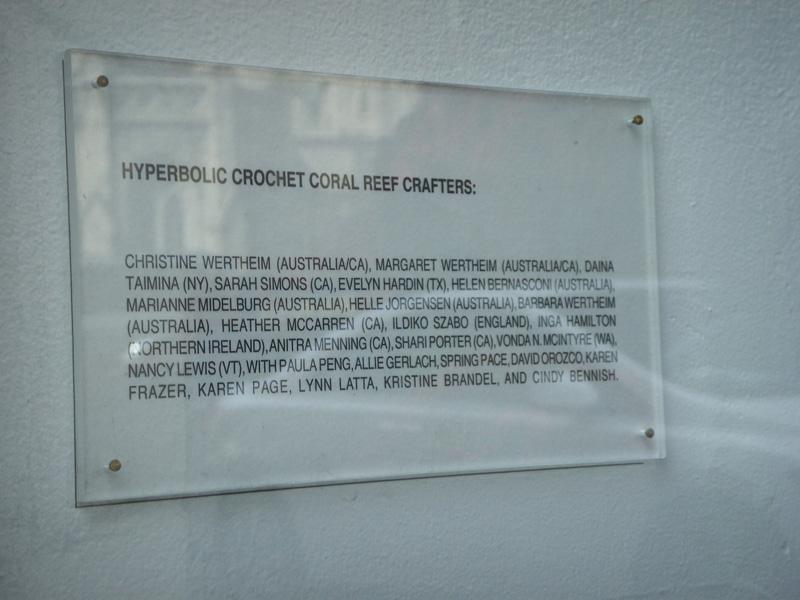 Detail of plaque describing the crochet coral reef exhibition.