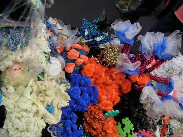 Cluster of crochet sculptures on the floor.
