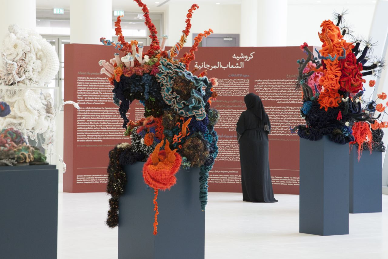 Crochet coral reef sculptures installed in the gallery