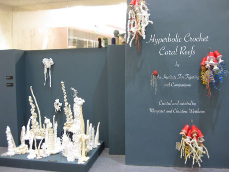 Installation view of crochet coral reef sculptures in large gallery space.