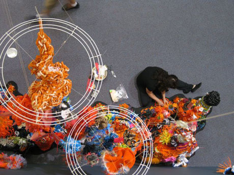 Detail of crochet coral reef sculptures installed on plinth in gallery.