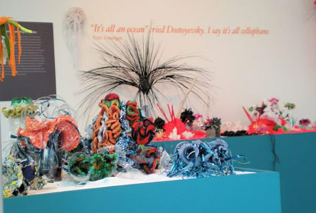 View of hyperbolic crochet coral reef sculpture installed in gallery.