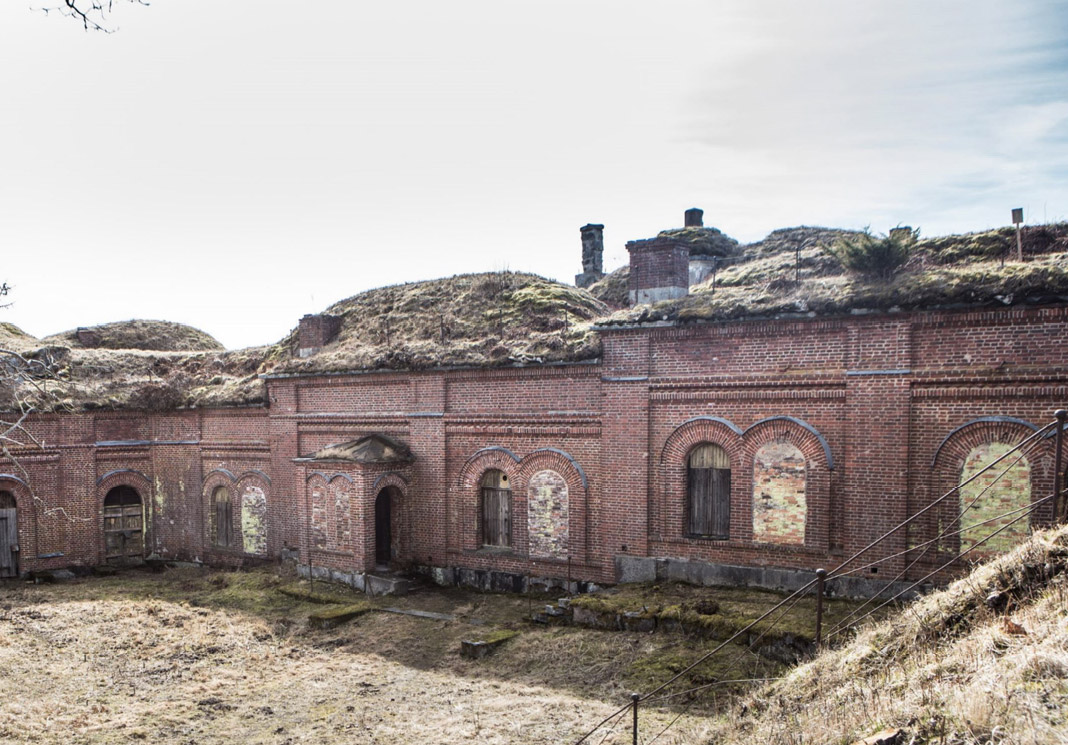 Old brick building ruins with mossy roofs