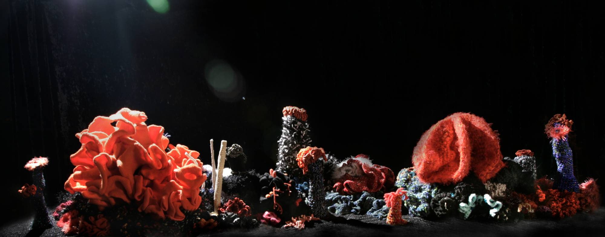 wide table top coral sculpture in oranges reds and blacks