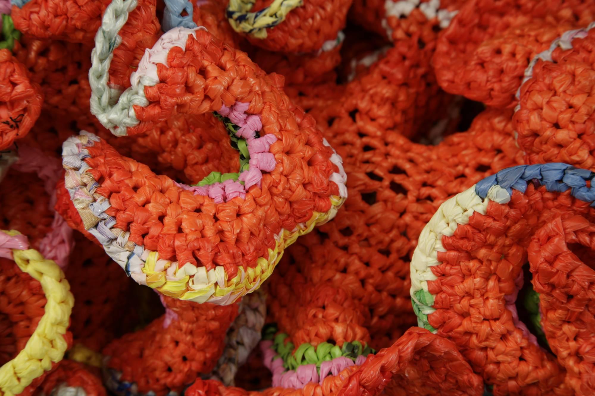crocheted plastic coral made of orange plastic