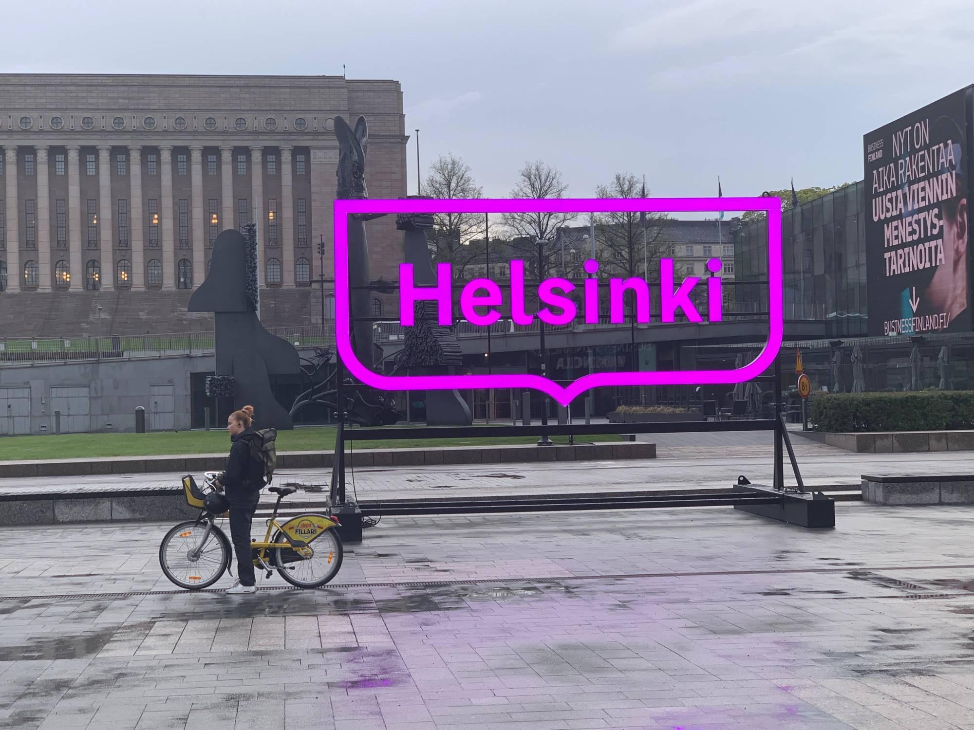 Neon sign spelling out Helsinki, in downtown Helsinki